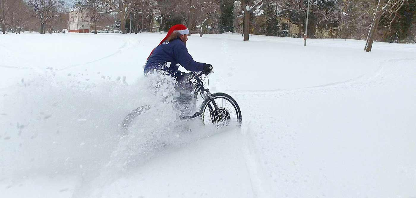 Electric bicycle in the deep snow